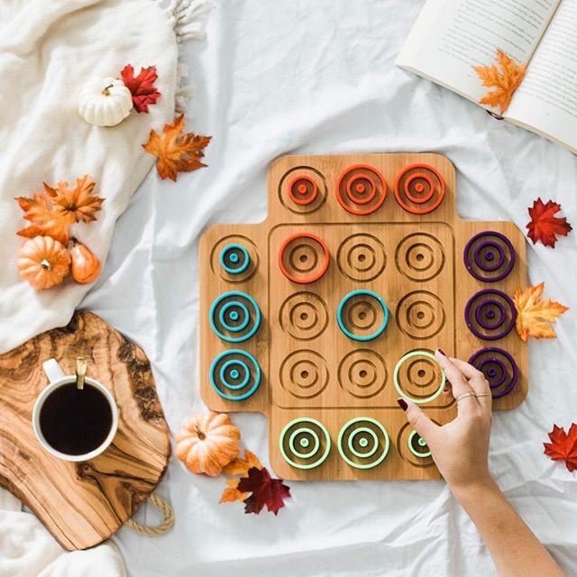 It's the most #colorful time of the year ️  Our favourite way to spend it is a cup of hot coffee and a game of #Ortio by @spinmaster. How about you?   #Autumn #AutumnPallet #ClientLove #StrategyGames #Leaves #CoolWeather #FamilyTime #MeTime #Thinking #BoardGame #Otrio #Seasonal #Pumpkin #SweaterSeason #FallLeaves